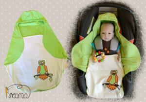 Einschlagdecke-Sommer-Trico-Applikation-Eule-grün-natur-mit-Puppe-in-Babyschale-Shop