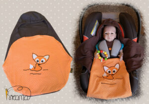 Einschlagdecke-Sommer-Trico-Applikation-Fuchs-braun-Punkte-orange-mit-Puppe-in-Babyschale-Shop