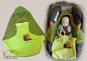 Einschlagdecke-Sommer-Trico-Applikation-Schnecke-kaki-Punkte-grün-mit-Puppe-in-Babyschale-Shop