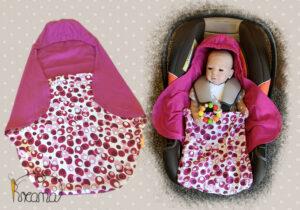 Einschlagdecke-Sommer-Trico-Tupfen-beere-pink-mit-Puppe-in-Babyschale-Shop