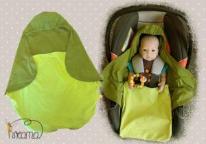 Einschlagdecke-Sommer-Trico-kaki-Punkte-grün-mit-Puppe-in-Babyschale-Shop