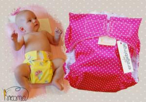 Gewebespreizhose, Spreizwindelhose Punkte pink mit Baby